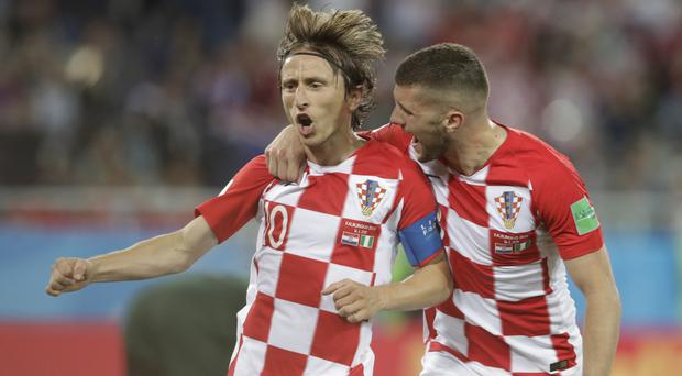 Croatia captain Luka Modric (left) hopes his side can take momentum into the match against Argentina (Petr David Josek/AP)
