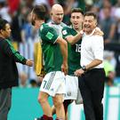 Juan Carlos Osorio celebrates with his players after the final whistle (Tim Goode/Empics)