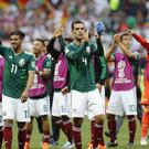 Mexico celebrate a famous win (Antonio Calanni/AP)
