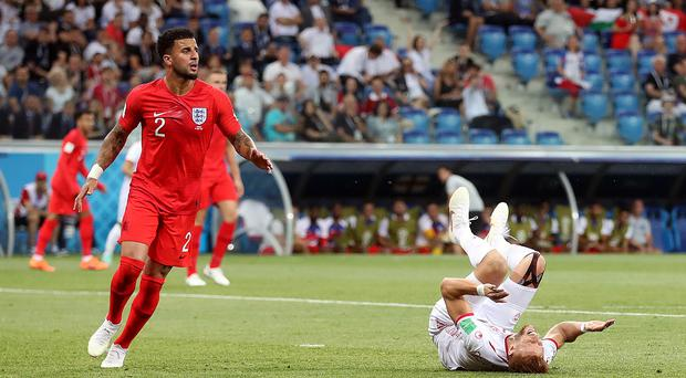 England's Kyle Walker (left) concedes a penalty after colliding with Tunisia's Fakhreddine Ben Youssef. (Adam Davy/PA)