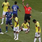 Referee Damir Skomina dismissed Carlos Sanchez (centre) in the fourth minute (Vadim Ghirda/AP)