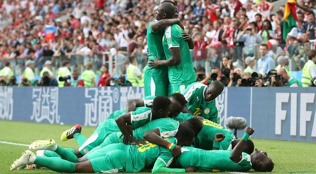 Senegal celebrate their second goal (Adam Davy/EMPICS)