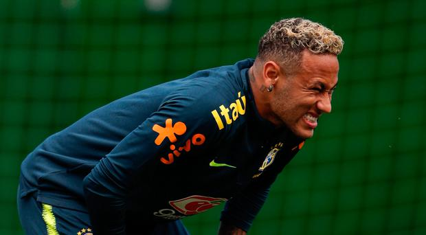 Pain game: Neymar grimaces during yesterday's session