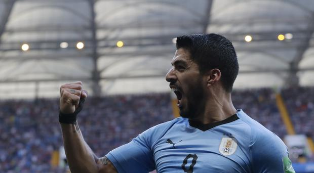 Luis Suarez celebrates scoring against Saudi Arabia (Andrew Medichini)