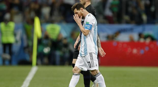 Lionel Messi leaves dejected at full-time (Ricardo Mazalan/AP)