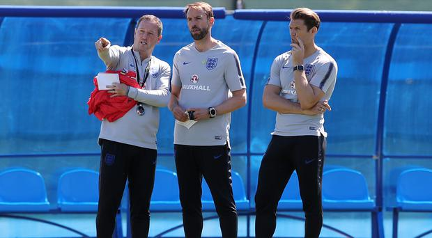 Did assistant manager Steve Holland, left, inadvertently give away England's tactics? (Owen Humphreys/PA)