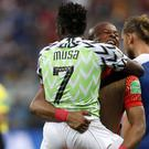 Nigeria earned their first win of the tournament (Darko Vojinovic/AP)