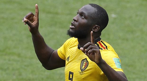 Belgium striker Romelu Lukaku took both his goals beautifully against Tunisia but limped off before the hour mark (Victor Caivano/AP)