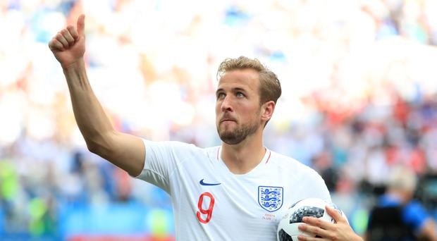 England's Harry Kane celebrates with the match ball (Adam Davy/PA)