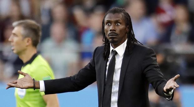 Senegal coach Aliou Cisse on the touchline (Natacha Pisarenko/AP)