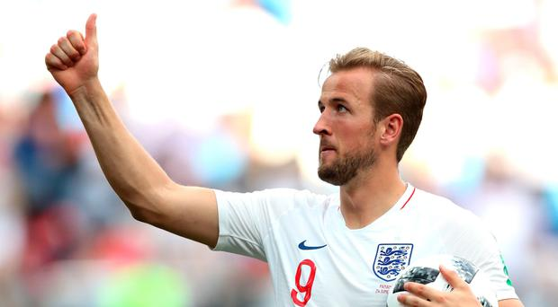 Having a ball: Harry Kane shows off his prize after netting a hat-trick in England's victory against Panama