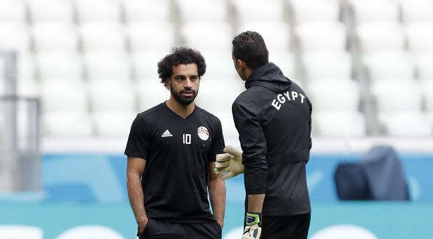 Liverpool forward Mohamed Salah trained with Egypt on Sunday as speculation about his international future continues (Darko Vojinovic/AP).