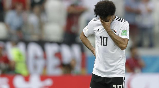 Mohamed Salah scored twice in the tournament but Egypt were eliminated (Andrew Medichini/AP)