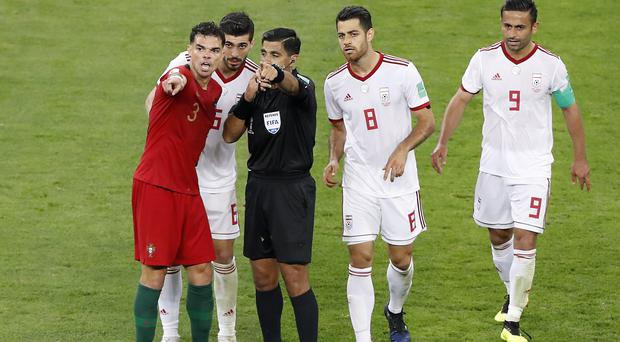 Iran snatched a 1-1 draw with Portugal after scoring a late penalty awarded with the aid of VAR (Darko Bandic/AP)