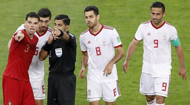 The video assistant referee system caused controversy in the Iran-Portugal match (Darko Bandic/AP)