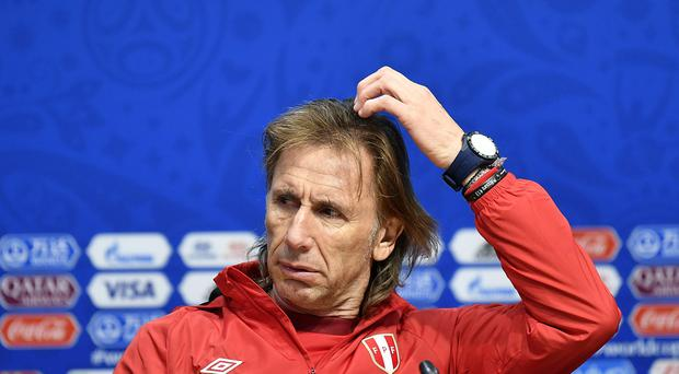 Peru head coach Ricardo Gareca is considering his next move after their exit from the tournament (Martin Meissner/AP).
