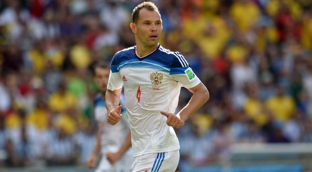 Russia defender Sergei Ignashevich is targeting a World Cup upset against Spain (Joe Giddens/Empics)