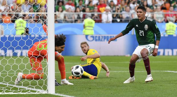 Edson Alvarez, right, scored an own goal to give Sweden a 3-0 lead over Mexico (Martin Meissner/AP)