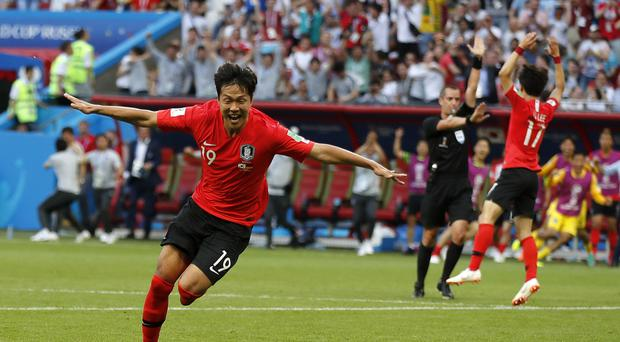 South Korea's Kim Young-gwon celebrates scoring his sides first goal against Germany (Frank Augstein/AP)
