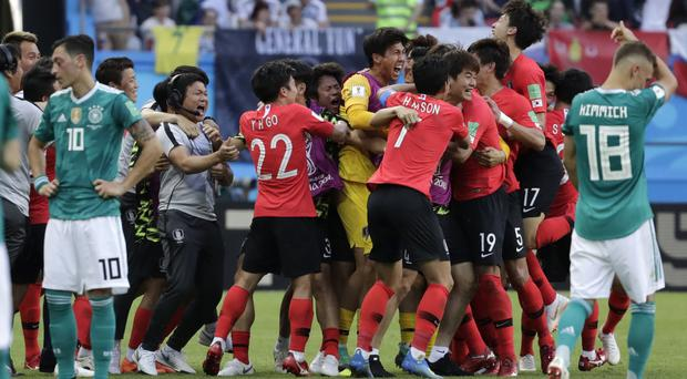 South Korea recorded a memorable victory as the holders crashed out of the World Cup. (Lee Jin-man/AP Photo)