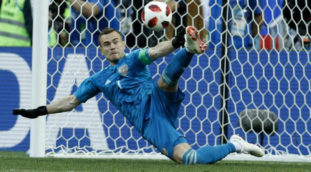 Igor Akinfeev had already put in a captain's performance before saving Iago Aspas' penalty in the shoot-out (Victor Caivano/AP)