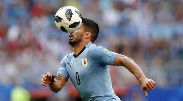 Uruguay's Luis Suarez controls the ball during the group A match between Uruguay and Russia at the 2018 soccer World Cup at the Samara Arena in Samara, Russia, Monday, June 25, 2018. (AP Photo/Rebecca Blackwell)