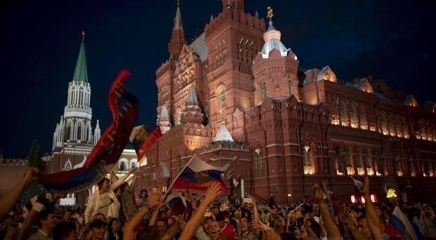 Russia fans have been celebrating an unexpected run to the quarter-finals of the World Cup on home soil. (Victor R. Caivano/AP)