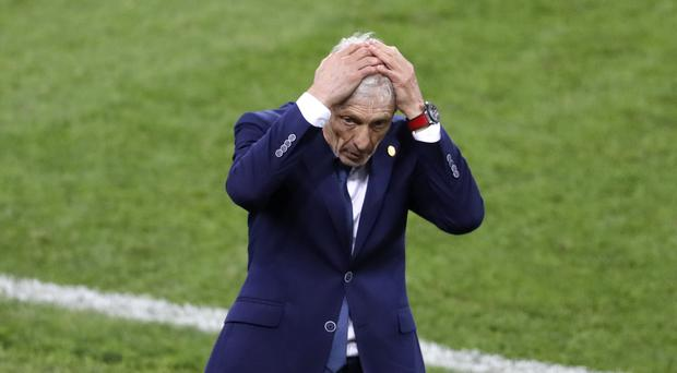 Jose Pekerman reacts after Jordan Pickford saves Colombia's fifth penalty in the shoot-out to seal a 4-3 win (Antonio Calanni/AP)