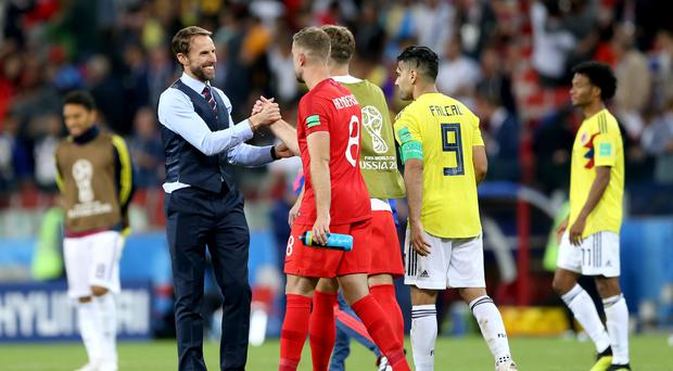 England manager Gareth Southgate,left, celebrates with Jordan Henderson after beating Colombia (Tim Goode/PA)