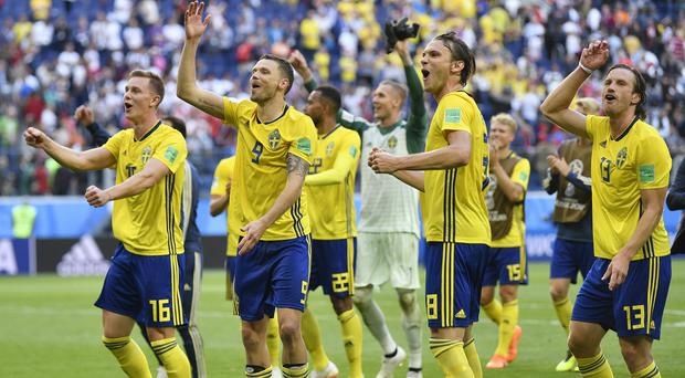 Sweden celebrate after their last 16 victory over Switzerland (Martin Meissner/AP)