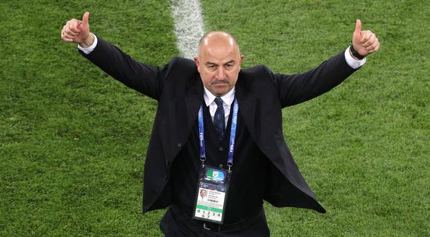 Russia manager Stanislav Cherchesov is trying to stay grounded amid all the hype of the hosts' progress (Owen Humphreys/PA).