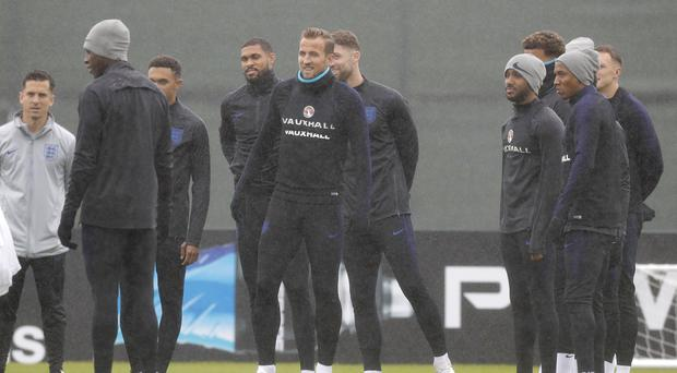 The England squad braved the rain in Russia to prepare for Saturday's quarter-final clash with Sweden. (Dmitri Lovestsky/AP)