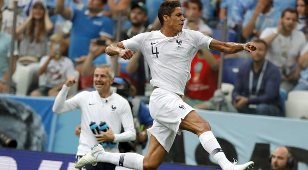 Raphael Varane put France on their way to victory (Ricardo Mazalan/AP)