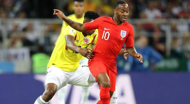 Raheem Sterling (right) has seen his postion in the England team come under scrutiny. (Owen Humphreys/PA Images)