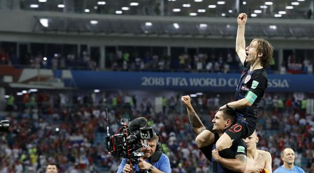 Croatia's Luka Modric leads the celebrations after their penalty shoot-out win over Russia (Rebecca Blackwell/AP)