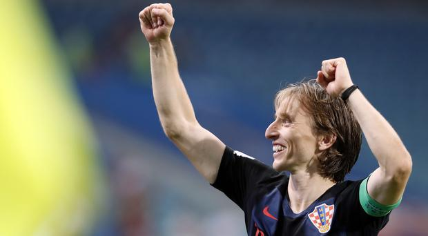 Croatia captain Luka Modric (centre) helped his team see off hosts Russia after a penalty shootout to reach the World Cup semi-finals. (Rebecca Blackwell/AP/Press Association Images)