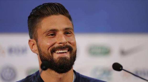 Olivier Giroud told a press conference he thinks fellow countryman Hugo Lloris is a better goalkeeper than Chelsea team-mate Thibault Courtois (David Vincent/AP)