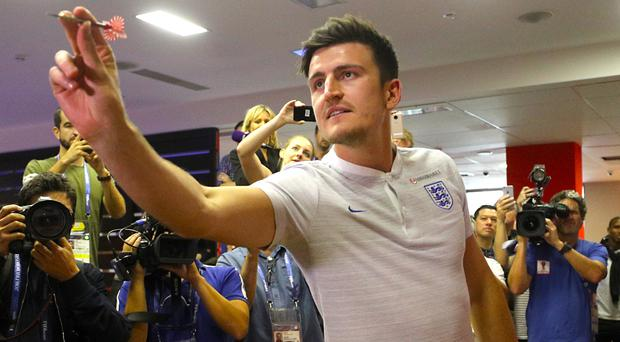 England defender Harry Maguire plays darts during the media access at Repino Cronwell Park (Owen Humphreys/PA)