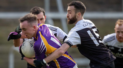 Caught up: Aidan Branagan and Conor Laverty of Kilcoo get to grips with Derrygonnelly's Ronan McHugh