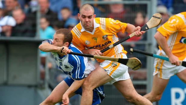 New challenge: Johnny Campbell, in his Antrim playing days and now, is relishing Saffrons backroom role under Darren Gleeson