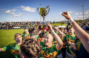 Champions: Dunloy celebrate as they win the Antrim Senior Hurling Championship