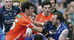 Getting shirty: Armagh and Cavan players scuffle before Sunday's Ulster Championship clash