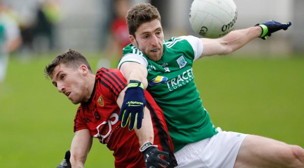 Close up: Down's Jonny Flynn clashes with Eoin Donnelly
