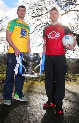 Up for the cup: Donegal's Frank McGlynn and Down's Mark Poland at the launch of the Allianz National League at Malone House in Belfast yesterday