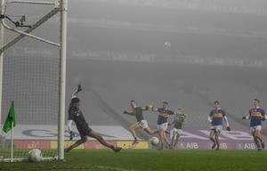 Mayo's Cillian O'Connor scores their fifth goal past Tipperary goalkeeper Evan Comerford in the fog of Croke Park