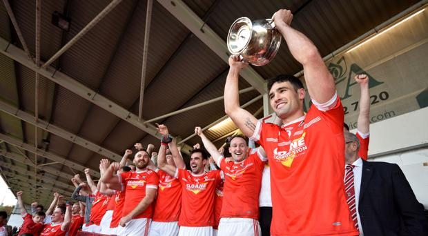 Silver lining: Magherafelt captain Danny Heavron raises the John McLaughlin Cup aloft