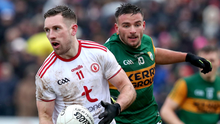 Closing in: Kerry's Michael Burns puts pressure on Niall Sludden