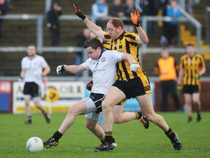 Closely run: Omagh ace Stephen Mullan and John Haran of St Eunan's tussle for possession