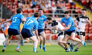 Gripping contest: Kilcoo's Conor Lavery with Shane Annett of Mayobridge in last year's Down SFC final