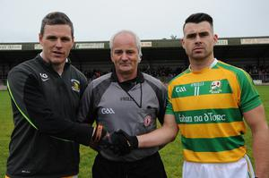Going strong: Conor Gormley (left) gets ready for last year's Tyrone Championship, shaking hands with Edendork captain Darren McCurry with referee Brian McCallion in the middle